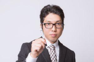 ペンを持つビジネスマン